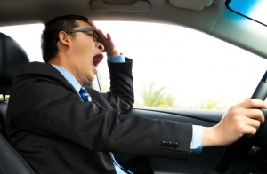 Exhausted driver yawning and driving  car